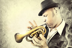 Blues man performing with his trumpet in the night. With passion Royalty Free Stock Photo