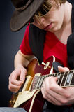 Blues musician. A blues guitarist playing a tune on his instrument Royalty Free Stock Photo