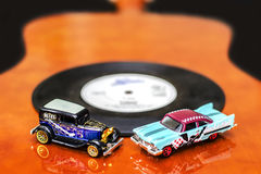 Blues and Rock Cars. Vintage Blues and Rock Cars Miniature on Guitar Stock Photos