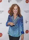 Elvis Costello. Blues singer and songwriter, Bonnie Raitt arrives for the Little Kids Rock Gala at the PlayStation Theater in New York City on October 18, 2017 Stock Images