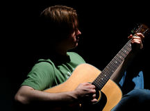 Blues Time. Portrait of male playing acoustic guitar Stock Images
