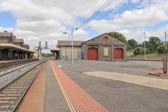 Bluestone Kyneton railway station building, platforms, goods. The bluestone Kyneton railway station building, platforms, goods shed and weatherboard signal box stock images