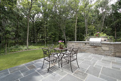 Bluestone patio and stone grill stock photo