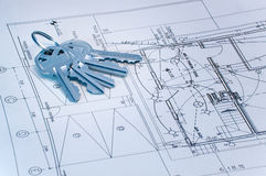 Bluetone keys over construction plans. Blue tone image of keys over some technical drawing Stock Photos
