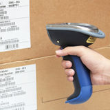 Bluetooth barcode and QR code scanner. Scanning boxes with buletooth barcode scanner Royalty Free Stock Photo