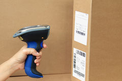 Bluetooth Barcode and QR Code Scanner. Showing scan barcode lebel on the box Stock Photography