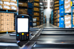 Bluetooth barcode scanner. In front of modern warehouse Stock Photography