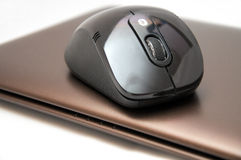 Bluetooth black Mouse on the laptop Stock Image