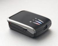 Bluetooth GPS Receiver. Close-up of a tiny Bluetooth GPS receiver Royalty Free Stock Photos