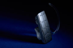 Bluetooth Headset. On black background Stock Photography