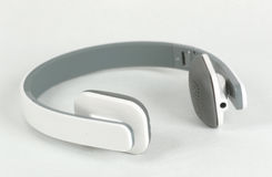 Bluetooth wirelles headset. Laying on white background Stock Photo