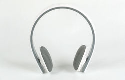 Bluetooth wirelles headset. Laying on white background Stock Photos