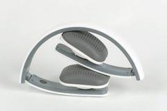 Bluetooth wirelles headset. White-gray bluetooth wirelles headset, white background Royalty Free Stock Image