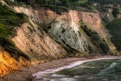 Free Bluff Cove Cliffs At Sunset Royalty Free Stock Photography - 139254647