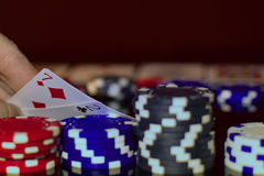 Bluffing in Texas hold`em. Poker player has 2 and 7 off suit, avery bad pocket cards stock photo