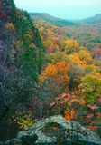 Bluffs and autumn. Limestone bluffs along the edge of a valley frame an autumn valley royalty free stock photos