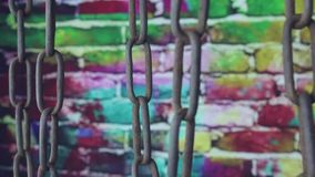 Bluish old chain on color background stock video footage