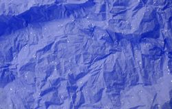 Sparkly Tissue Paper Background. Bluish purple wrinkled tissue paper with sparkles. Close up. Horizontal. Background Royalty Free Stock Photography