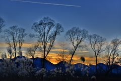 The Night view in the winter time. When the plane adds some magic in this blue winter sunset royalty free stock image