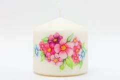 Blumen auf einer Kerze Lizenzfreie Stockbilder