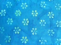 Blumen auf Gewebe Stockbild