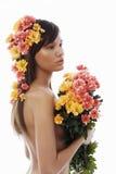 Blumen in ihrem Haar Stockfoto