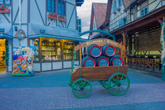 BLUMENAU, BRAZIL - MAY 10, 2016: small ancient cart with some beer barrels on it parked infront of some german style houses royalty free stock photography
