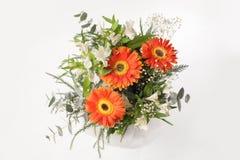 Blumenblumenstrauß auf Grau Stockfotografie