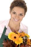 Blumenhändlerholdingblumen Stockbilder