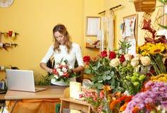 Blumenladeninhaber stockbilder