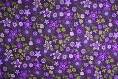 Blumenmustergewebehintergrund Stockfoto