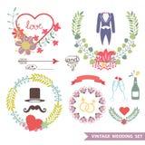 Blumensatz der netten Weinlese mit Hochzeitseinzelteilen Stockfoto
