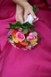 Blumenstrauß auf Kleid Stockfotos