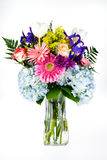 Blumenstrauß der bunten Blumen in einem GlasVase. Stockfotografie