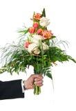 Blumenstrauß in der Hand Lizenzfreie Stockbilder