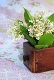 Blumenstrauß der Lilien des Tales Stockfotografie