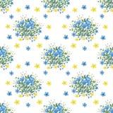 Blumenstrauß von blauen und gelben Blumen Stockbilder