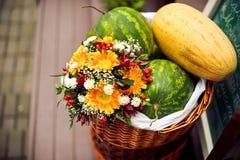 Blumenstrauß von Gerberas, Melonen Stockbild