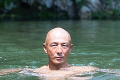 Blunt Japanese bald head guy soaked in the river Royalty Free Stock Images
