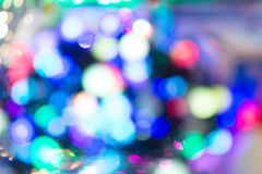 Blur abstract lights with bokeh effect on colorful blurred background Stock Images