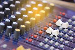 Blur with the audio mixer in the control room. Mixer level control knob in the control room and sound recorder royalty free stock photo