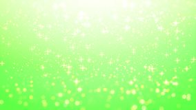 Blur background with bokeh effect, Out of focus background. Colo. Rful lights bokeh on green background, blur dust motion graphic, Particle motion, green Royalty Free Stock Photography