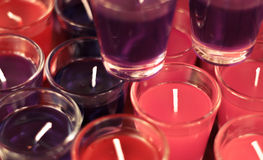 Blur background colorful candle in glass by vintage tone. Royalty Free Stock Photography