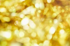 Blur background of gold color bokeh light. Blur background of gold color bokeh light, Popular in the general festival. Make the luxury image in your work piece Royalty Free Stock Photos