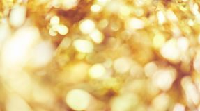 Blur background of gold color bokeh light, Popular in the general festival. Make the luxury image in your work piece.  royalty free stock photography