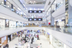 Blur background image of shopping mall or department store with. Bokeh and people background usage concept Royalty Free Stock Images