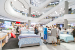 Blur background image of shopping mall or department store with. Bokeh and people background usage concept Stock Photography