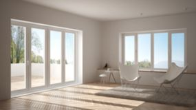 Blur background interior design, minimal living room with armchair carpet, parquet floor and panoramic window. Scandinavian architecture stock photography