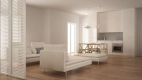 Blur background interior design, modern clean living room with kitchen and dining table, sofa, pouf and chaise longue, minimal. Architecture royalty free stock image