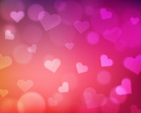 Blur background with love theme - hearts and light orbs - pink. Blurred background with light reflection, orbs and hearts. Love themed valentine's day Royalty Free Stock Photography